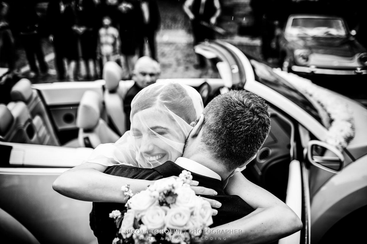 bride and groom hugs